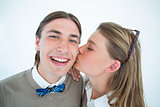Pretty geeky hipster giving boyfriend kiss on the cheek