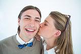 Pretty geeky hipster giving boyfriend kiss on the cheek