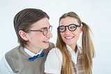 Geeky hipster couple smiling at each other