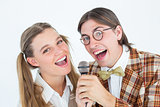 Happy geeky hipsters singing with microphone