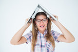 Geeky hipster holding her laptop over her head