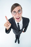Geeky businessman pointing up