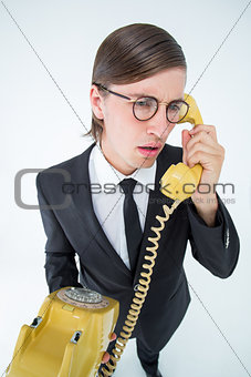 Focused geeky businessman on the phone