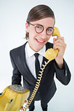 Smiling geeky businessman on the phone