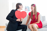 Cute geeky couple with red heart shape