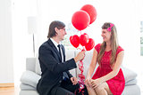 Cute geeky couple with red balloons