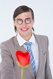 Geeky businessman offering a rose