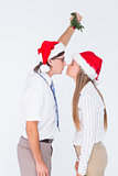 Geeky hipster kissing under mistletoe