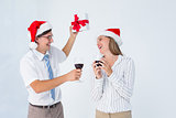 Happy geeky hipster couple drinking red wine