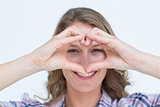Smiling hipster doing heart shape with her hands