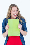 Smiling student holding notebook