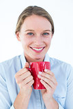 Businesswoman holding her mug and smiling