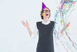 Happy geeky hipster wearing a party hat