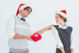 Geeky hipster offering present to his girlfriend