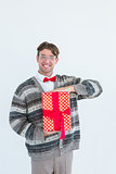 Happy geeky hipster with wool jacket holding present