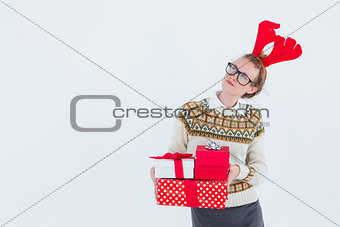 Thoughtful geeky hipster holding presents