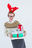 Happy geeky hipster holding presents