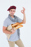 French guy with beret holding baguettes