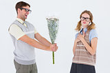 Geeky hipster offering flowers to his girlfriend