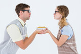 Geeky hipster couple holding pasta