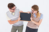 Geeky hipster couple holding little blackboard
