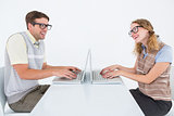Geeky hipster couple using laptop