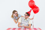 Geeky hipster couple celebrating his birthday