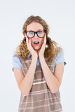 Geeky hipster woman putting her fingers in her ears