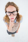Geeky hipster woman thinking with hand on chin