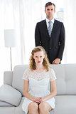 Serious couple looking at camera