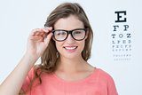Pretty hipster with glasses and eye test