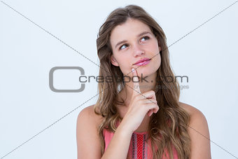 Thoughtful woman with finger on chin