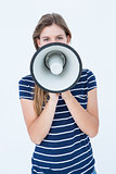 Woman speaking through a loudspeaker