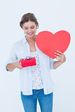 Woman holding a present and heart card