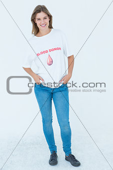 Blood donor with hands in pockets