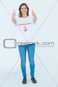 Blood donor showing thumbs up