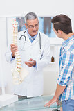 Doctor explaining the spine to his patient