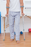 Patient standing with crutch
