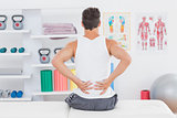 Young man suffering from back pain