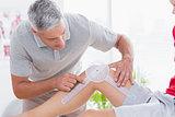 Doctor examining man leg