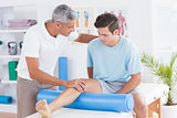 Doctor examining his patient leg