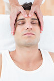 Man receiving head massage