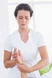 Physiotherapist doing hand massage