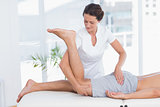 Physiotherapist doing leg massage to her patient