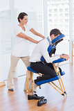 Businessman having back massage