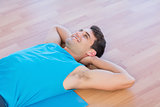 Smiling man lying on exercise mat