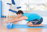 Man exercising with foam roller