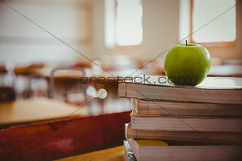 Apple on pile of books