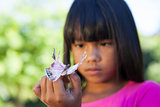 Cute little girl holding butterfly
