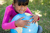 Cute little girl holding globe